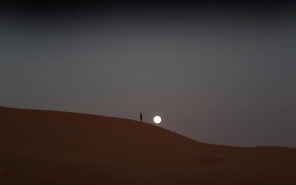 sun behine the sand dunes