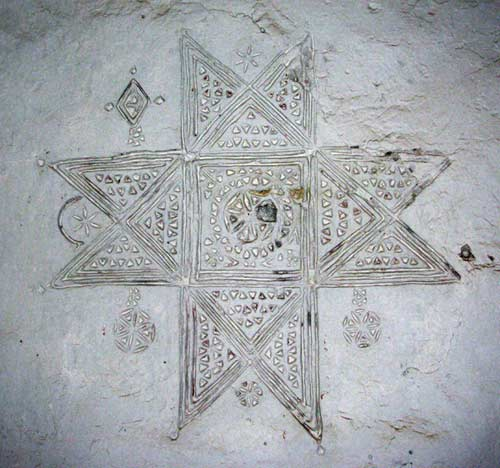 berber cross on a wall