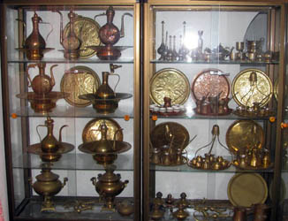 copper and brass ornaments on display