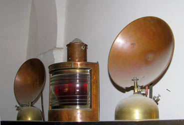 vintage copper and brass heaters and lights