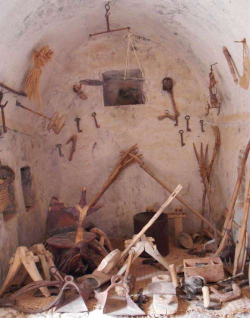 Qaser Alhaj interior showing wooden, stone and metal tools