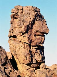 acacus, a rock carved by wind into the shape of an old man