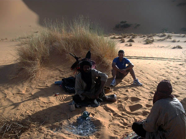 desert guides around a fire