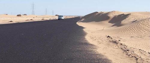 sand encroaching on tarmac road