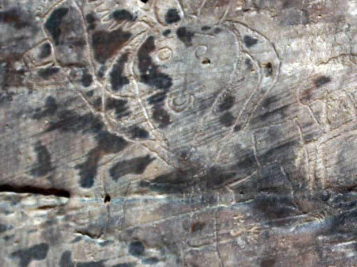 a prehistoric art painting from Acacus vandalised with graffiti
