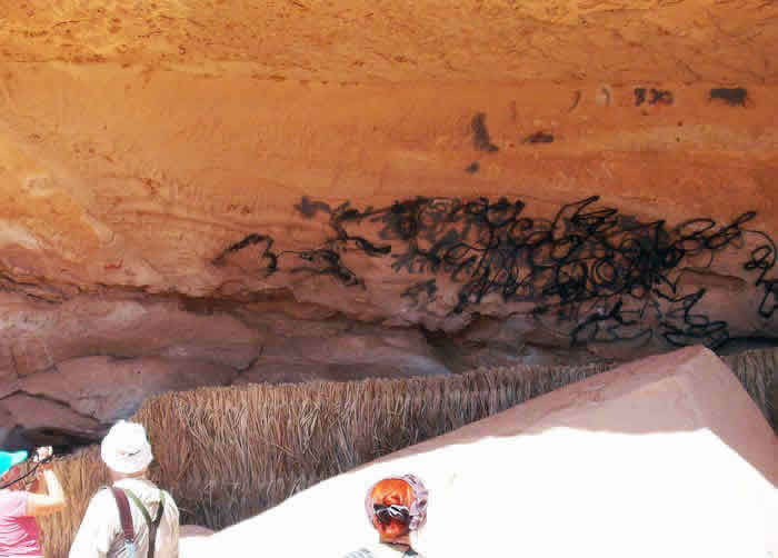 vandalised rock art site in Awiss