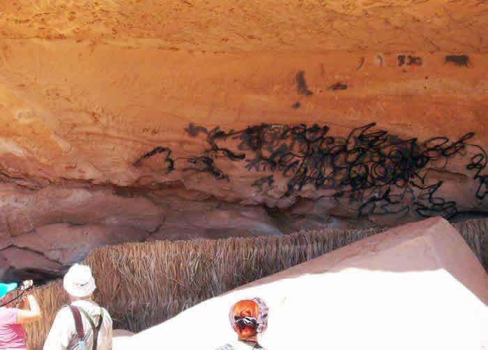 vandalised rock art site in Awiss