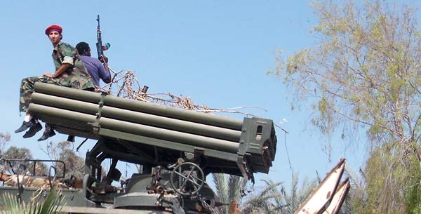 a rebel sitting on a missile launcher