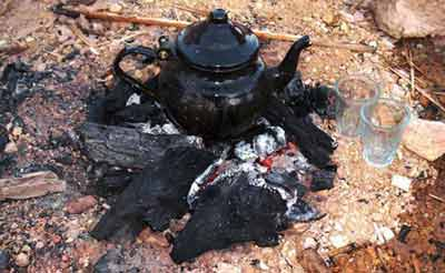 traditional Libyan tea pot, gently bubbling on embers