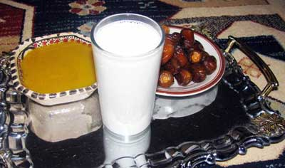 libyan traditional dish: palm dates, bsisa and a glass of milk