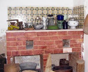 kitchen utinsils on display on brick top
