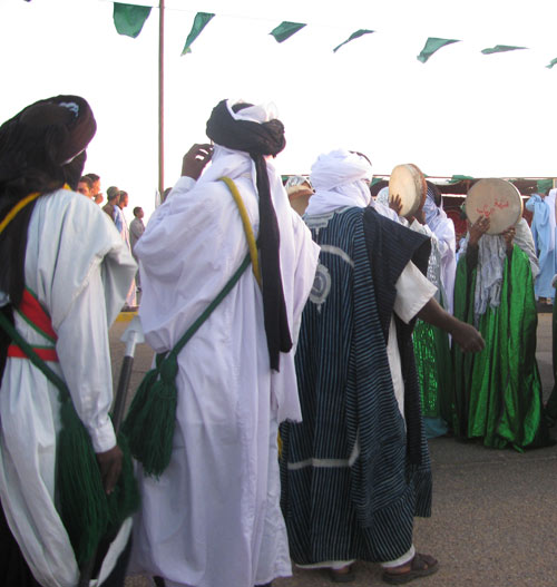 new Tuareg ghadames festival  adults dancing with women playing the tamborine