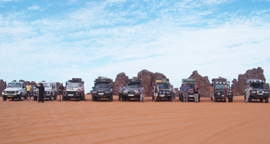 a group of cars in the desert