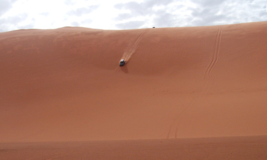 driving down a sand dune in the sahara