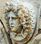 Medusa or gorgon's head looking left