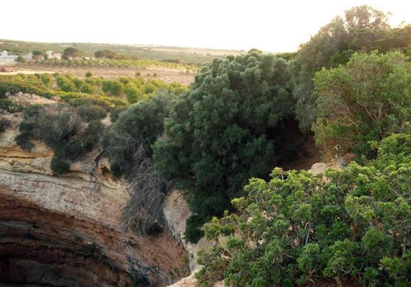 a big massive hole in the ground  near Cyrene at Hajyre