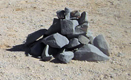 Newer stone pyramid road markers in the desert