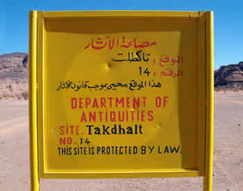 takdhalt site sign boed, yellow with blue sky background, showing the name of the protected site