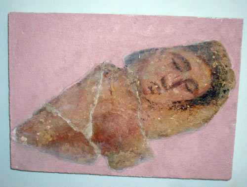 mosaic face with eyes closed as if sleep