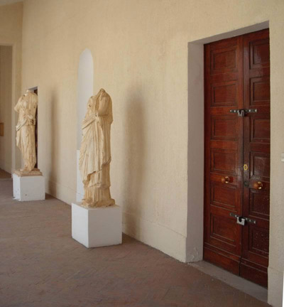 statues in the hall by the doors