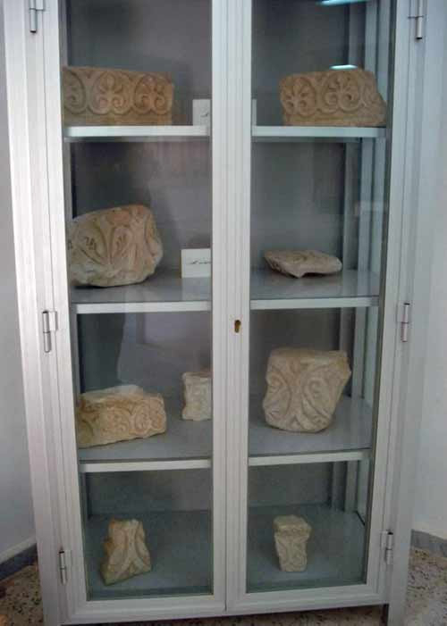 stones with designs inside a display cabinet.