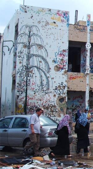gaddafi's house covered in grafitti