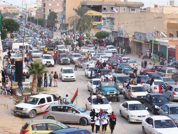 zuwarah a street full of people celebrating
