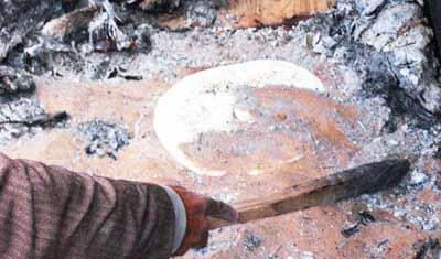 cooking bread in hot sand, Ghadames, Libya