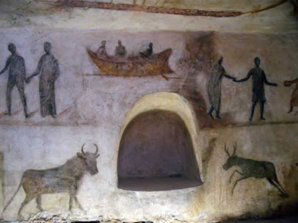 wall paintings from the tom, humans and animals