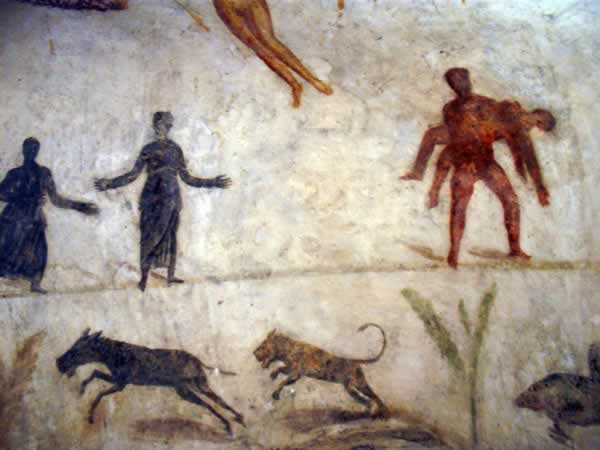 wall paintings: a man carrying a dead man, a lion chasing an animal