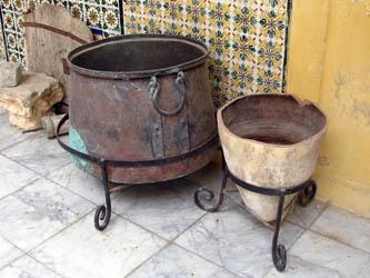 large copper saucpans or cooking copper pots