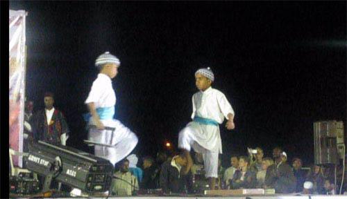 ghadames festival children dancing on stage