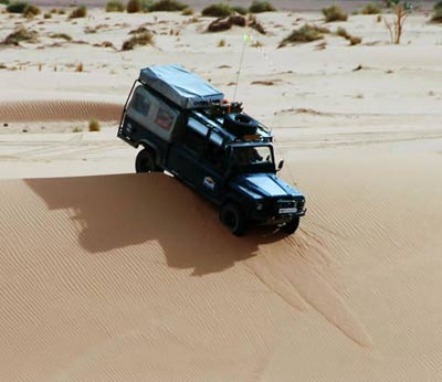 driving over a sand dune, acacus