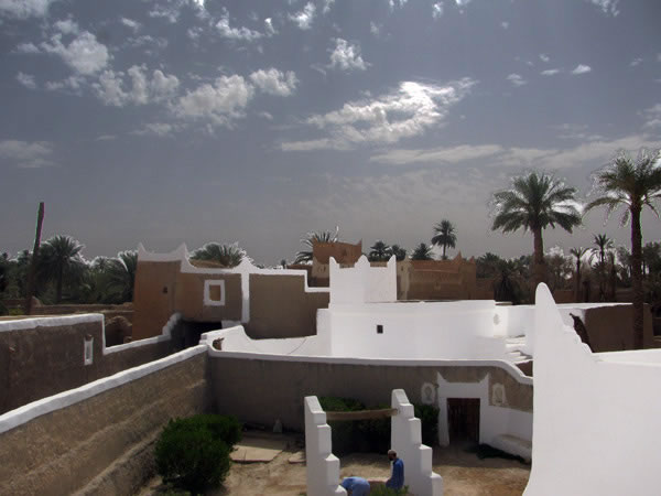 a view of ghadames houses with clouds shining beneath the sun