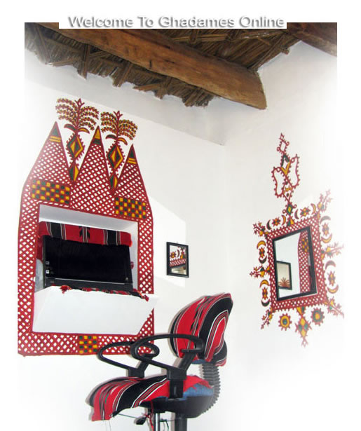 Ghadames: red paint designs on white walls
