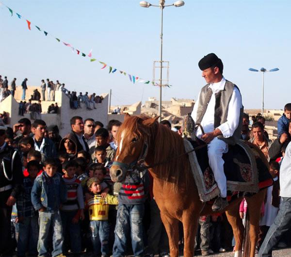 nalut festival man riding a horse