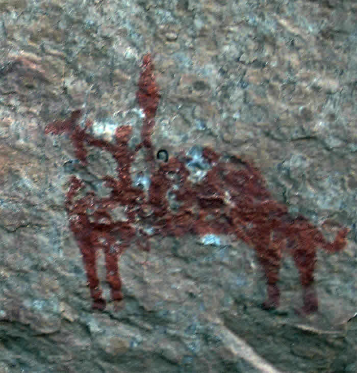 an abstract camel paintings with people on top