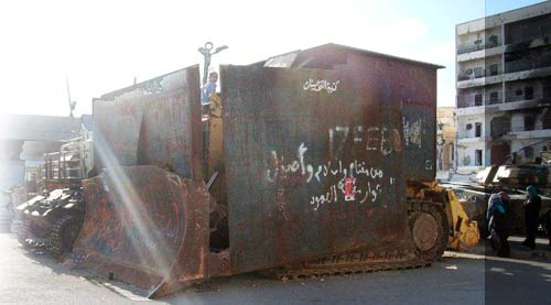 bulldozer shielded with metal sheets