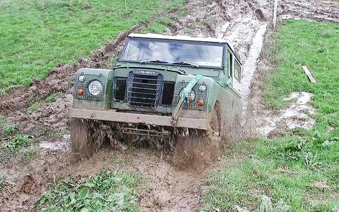 a landrover through wet mud